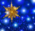 gold-snowflake-star-blue-stars-background-glitter-ornament-bokeh-copy-space-46069261